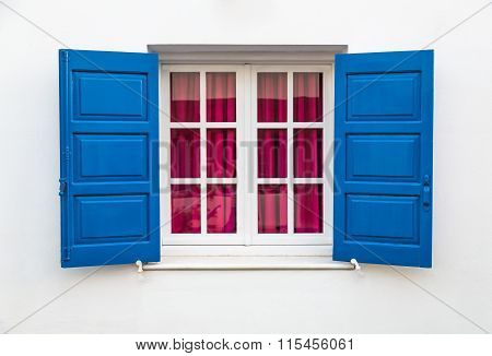 Window On White Wall With Blue Sun Blind