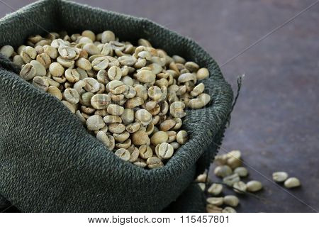 green coffee beans in a bag, antioxidant and healthy food