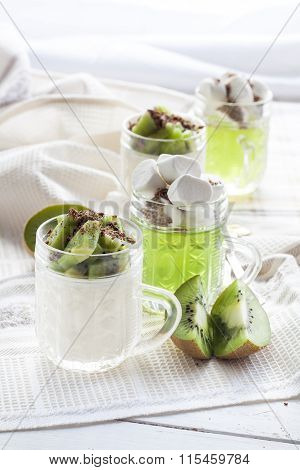 Vanilla panna cotta with kiwi and grated chocolate in glass