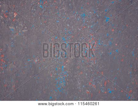 Dark metal surface with peeling paint. Weathered wall