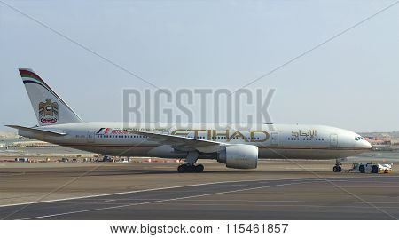 Aircraft Boeing 777 (A6-LRD) Etihad Airways is towed to the runway. The Airport Of Abu Dhabi