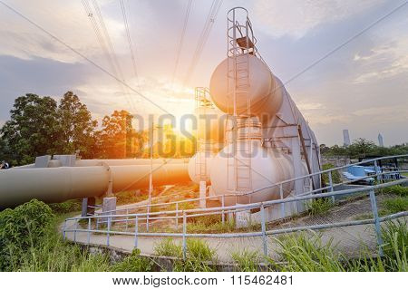 Oil and gas industry refinery factory at sunset, petrochemical plant