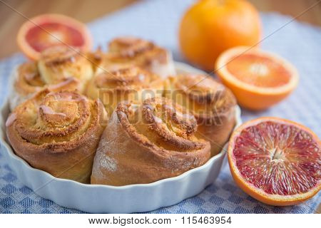 Home made sweet pastry rolls filled with blood orange and coconut