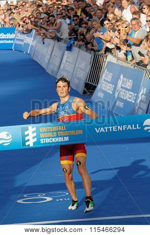Triathlete Javier Gomez Breaking The Finnish Line