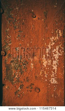 The flat metal surface painted in orange