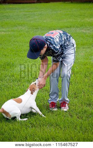 Young Baseball Boy And His Dog