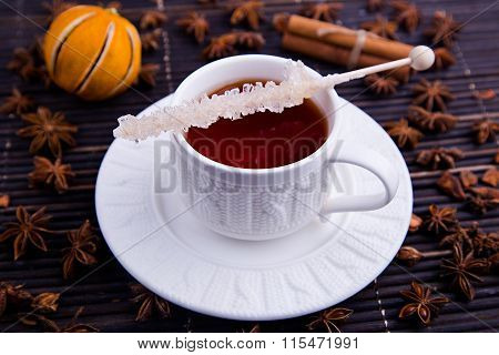 Cosy cup with rooibos tea and sugar stick a top