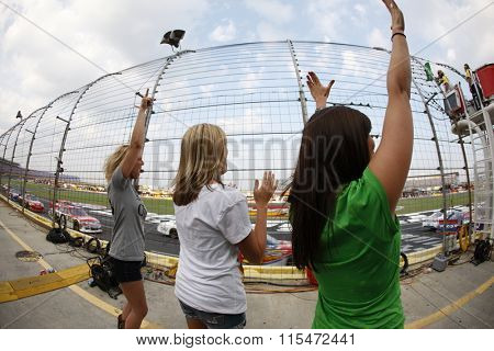 CONCORD, NC - MAY 29, 2011:  NASCAR fans show their support for their favorite team during the Coca-Cola 600 race at the Charlotte Motor Speedway in Concord, NC.