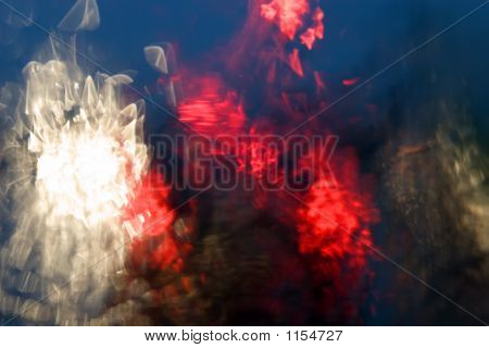 Car Tail Lights Through Rain Covered Windshield Abstract