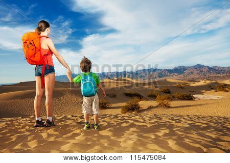 Hiker with selfie stick and son, Death valley