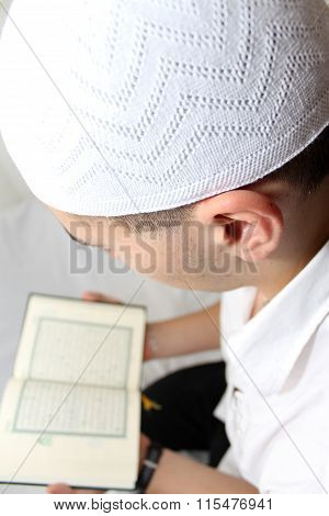 Muslim man Reading Holy Islamic Book Koran
