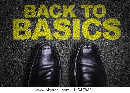 Top View of Business Shoes on the floor with the text: Back to Basics
