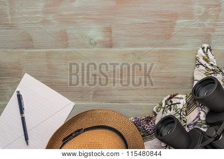 Travel, Summer Vacation, Tourism And Objects Concept - Close Up Of Binoculars, Hat, Pen, Paper And S