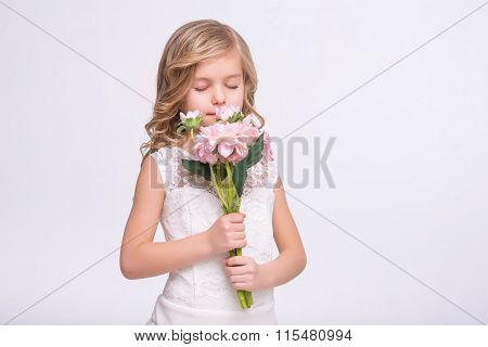 Cute little girl standing in  a wedding dress