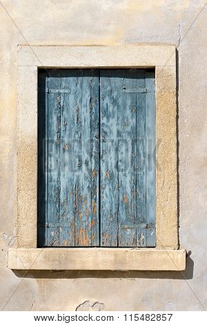 Closed Window With Blue Shutter