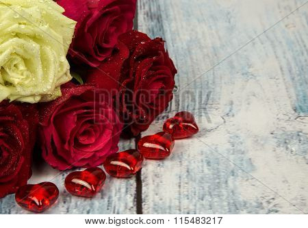 Five Roses And Red Hearts On A Background Of A Wooden Tabletop In A Vintage Style