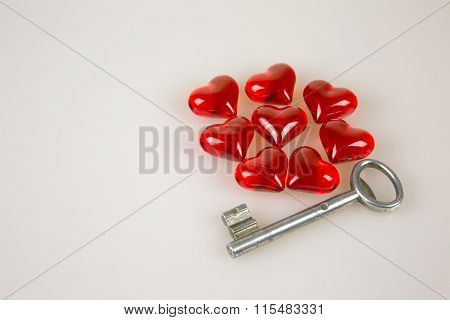 Valentine's Day, Small Red Hearts And Key Isolated White