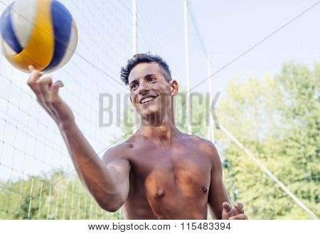Portrait Of Volleyball Player While Keeping Balancing Ball On A Finger
