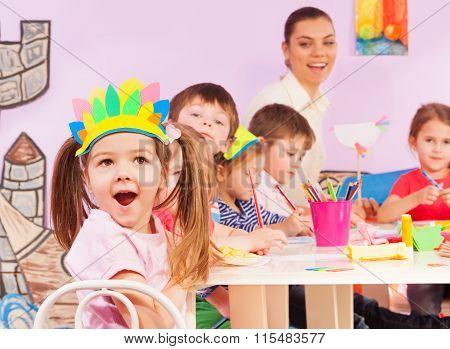 Girl portrait and kindergarten class