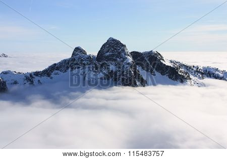 The Lions Above The Clouds In North Shore Mountains, Bc, Canada.