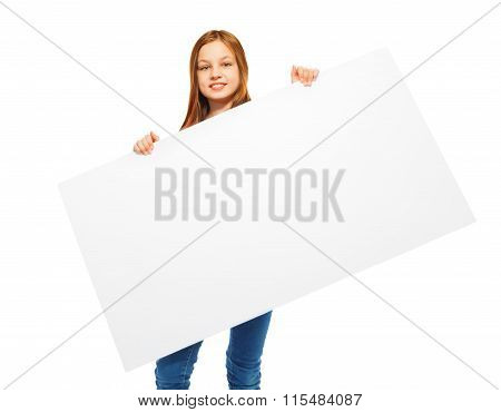 Nice young girl with advertising sign in her hand