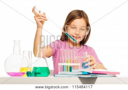 Young girl doing her chemical test in laboratory