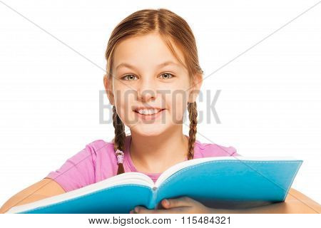 Clever smiling schoolgirl with a textbook