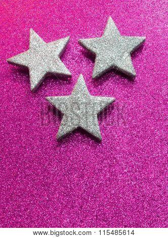 Three Silver Stars On Bright Violet Glittery Background