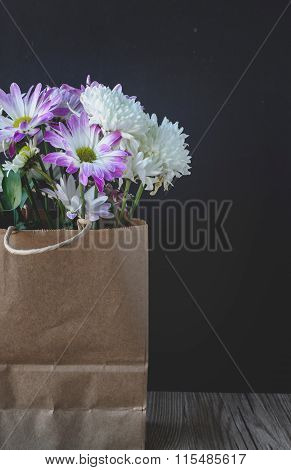 Flowers In Brown Paper Bag With Black Blank Space
