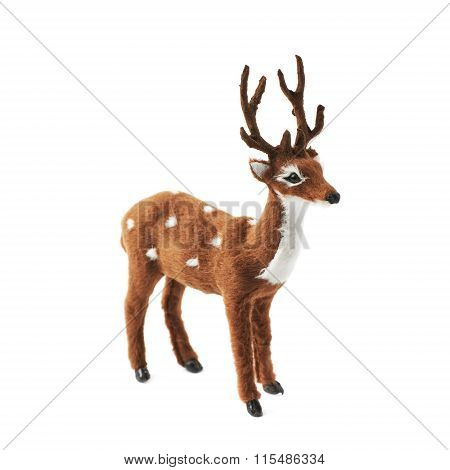 Toy roe deer fawn figurine isolated over the white background