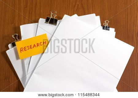Research; White Blank Documents With Small Message Card.