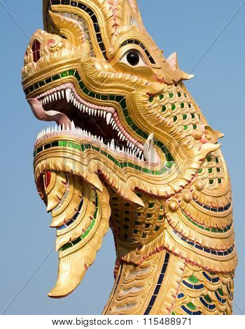 Golden Dragon Head With Dragon Fly Resting On Fang.