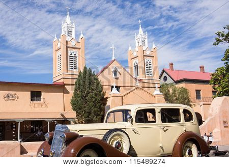 Restored Packard Vintage Car On Trailer In Front San Felipe De Neri Church Plaza, Albuquerque, New M