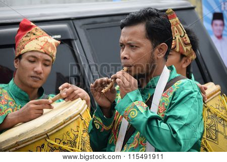 Blowing The Traditional Flute