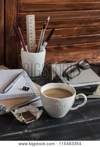 Workplace With Business Objects - Books, Notebooks, Pens, Tablet, Glasses And A Cup Of Coffee And Ch