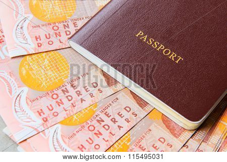 One Hundred New Zealand Cash Money Bank Note On Table With Red Cover Passport Book