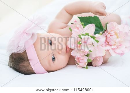 Cute infant lying in bed
