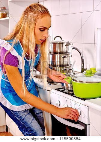 Young mistress woman cooking at kitchen.