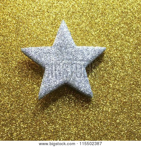 Large Silver Star In Brilliant Yellow Gold Background