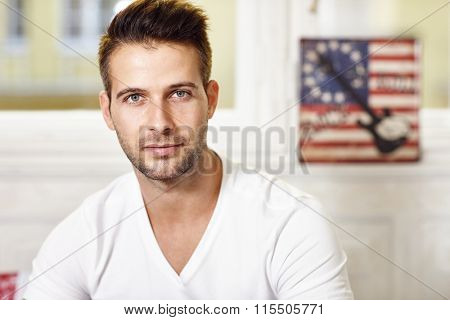 Portrait of handsome young man looking at camera.