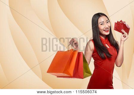 Chinese Woman In Cheongsam Dress Holding Shopping Bag