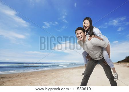 Happy Asian Couple Smiling On The Beach