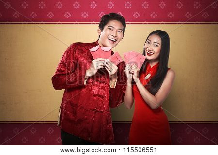 Asian Couple In Cheongsam Suit