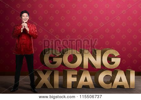 Gong Xi Fa Cai Writing And Chinese Man Smiling