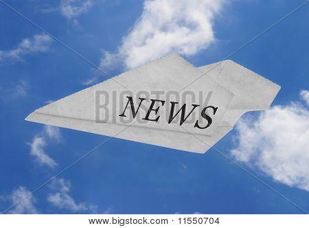 Newspaper plane on blue sky