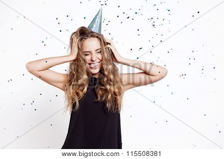 Girl At The Party In A Celebratory Cap On A Background Of Confetti