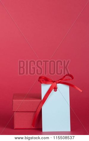 Gift Box And Empty Tag With Ribbon