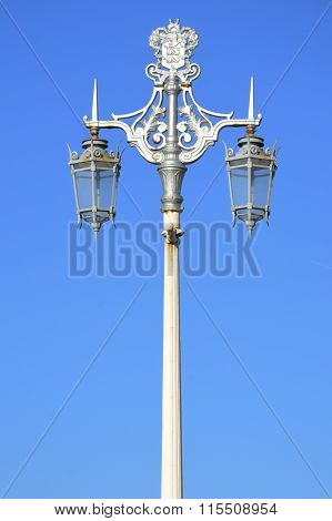Ornate street lamps in portrait landscape with blue sky