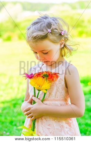 Portrait Of A Girl Of 6 Years With A Bouquet Of Gerberas