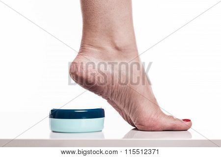 Care For Dry Skin On The Well-groomed Feet And Heels With Creams For The Skin And Feet
